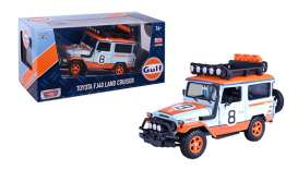 Toyota  - FJ40 1974 light blue/orange - 1:24 - Motor Max - 79658 - mmax79658 | The Diecast Company